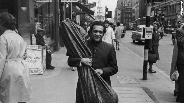 ravi shankar walking on street with sitar in his hand